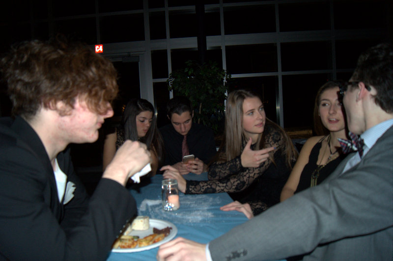 BLOT photo by Meagen Meagan McDowell.  Students converse over food and drink at Winterball.  The cost of the food and drink was included in the ticket.