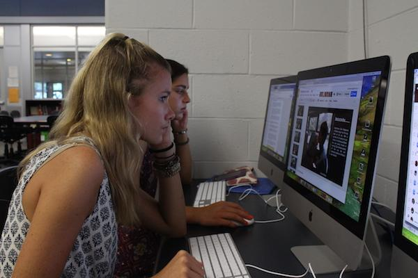 Junior Audrey Mannion of Brielle works on a photo slide show for Mass Media.