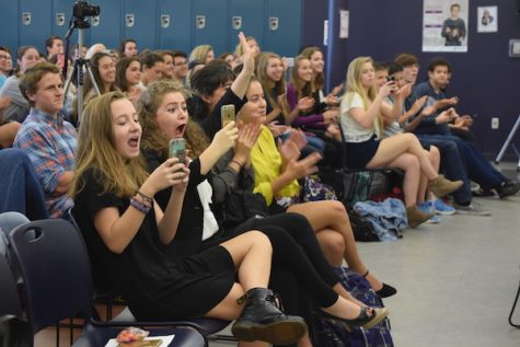 Students react to the candidates.