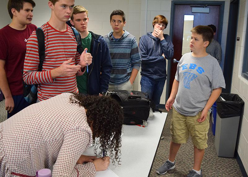 Students sign up to participate in the mock election.