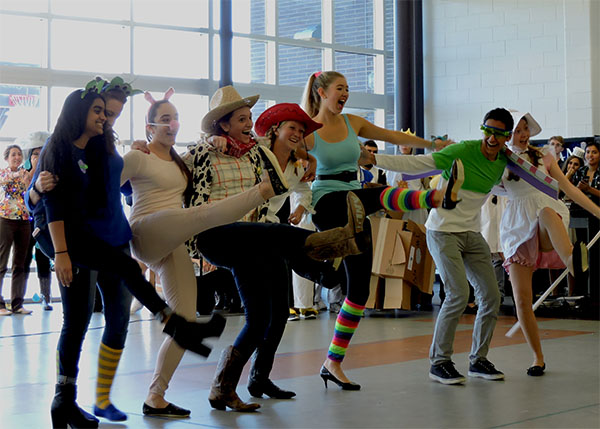"""Walking in to """"You've Got a Friend in Me,"""" a group of seniors won Best Group Costume after dressing up as the main characters from the Toy Story movies."""