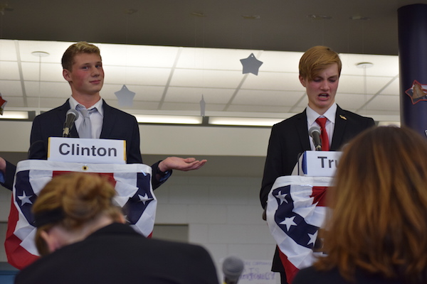 Hillary Clinton, represented by Matt Miller, and Donald Trump, represented by Jonathan Slovak, debated hot topics from immigration to college debt.