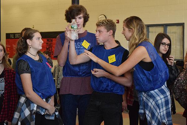 The senior team made sure to have the proper amount of water in their team bottle in a timed minute before the start of the Flip-Off.