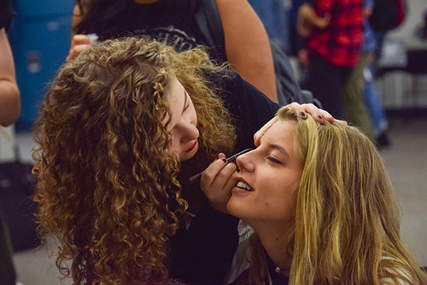 Junior Veronica Yaron of Little Silver helps fellow junior Abi Karl of Monmouth Beach get into the punk/grunge spirit. This is the second time Punk/Grunge Day has been a theme for CHS Spirit Week.