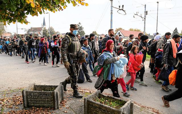 Syrian refugees and migrants pass through Slovenia.
