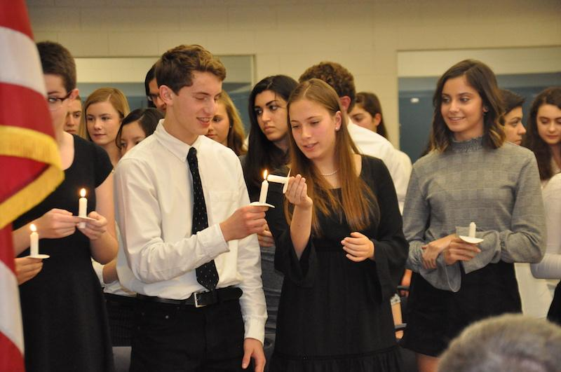 NHS Inductees light their ceremonial candles at the Dec. 7 Induction.