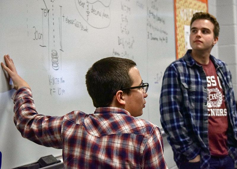Seniors Connor Bruneau, left, of Wall and John Hennessy of Middletown filled in for physics teacher Steve Godkin on Senior Switch Day.