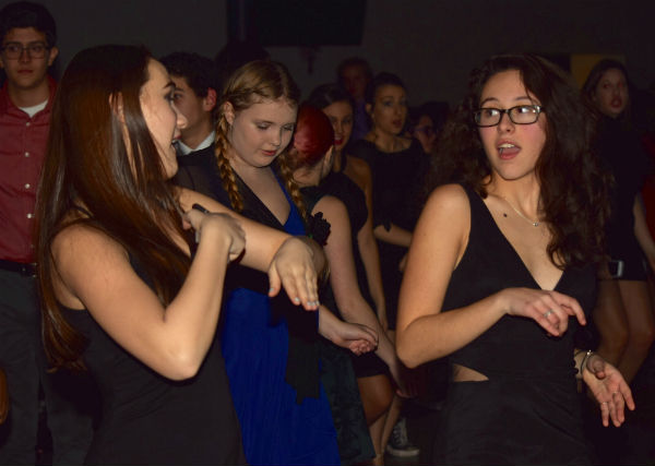 Juniors Sam LaRochelle (left) of Belford and Cara Pesciotta of Millstone enjoy their third Winterball while singing along to the DJ's music.