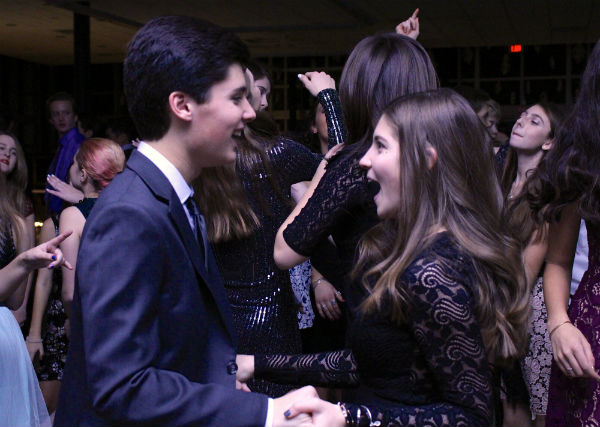 Sophomore Kyle Wheeler of Wall and his date, Kathryn Jemas of Long Branch, dance together for their second Winterball.