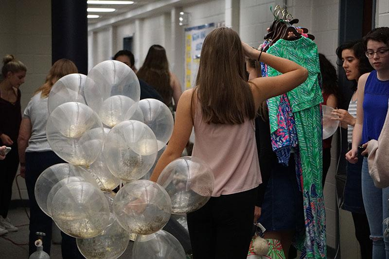 The CHS back hallway turned backstage is a bustling in the hours before the event. Committees had to set up decorations, food, music, lighting, ticketing, and dressing rooms before the show could begin.