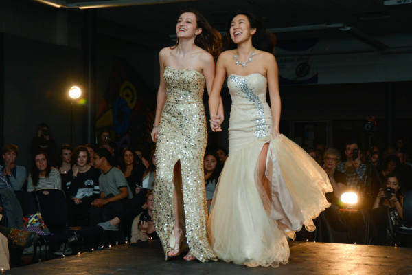 Seniors+Julia+Pardee+of+Freehold+and+Allie+Kuo+of+Tinton+Falls+walk+down+the+runway+together+in+their+gowns+from+Dresses+and+More.+The+two+had+been+planning+for+the+show+since+October.+