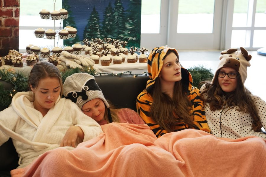 Seniors+Rachel+Van+Brunt%2C+Becca+Cleffi%2C+Gabrielle+Concepcion%2C+and+Rachel+Fenniman+huddled+under+a+blanket+to+portray+their+winter+theme.