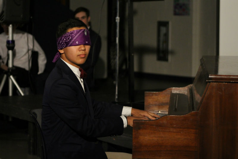 Freshman Evan Kuo of Tinton Falls impresses judges as he plays the piano blindfolded, earning him Best Talent of Mr. CHS.