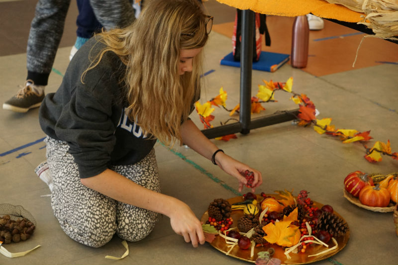 Junior Audrey Mannion of Brielle puts finishing touches on her grade's fall themed display.