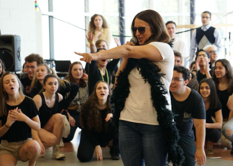 """Junior class adviser, Karen Britto, takes part in their class lip sync for a """"diva"""" mashup."""