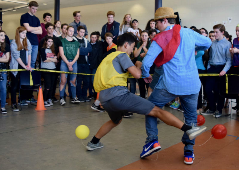 Freshman Evan Kuo of Tinton Falls, right, and senior Connor Bruneau of Wall compete in Balloon Pop. The freshmen earned first place, followed by seniors, sophomores and juniors, respectively.