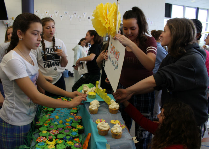 Monday's lunchtime event is Cupcake Wars, where each grade was pre-assigned a season to embody. The freshmen set up their spring display.