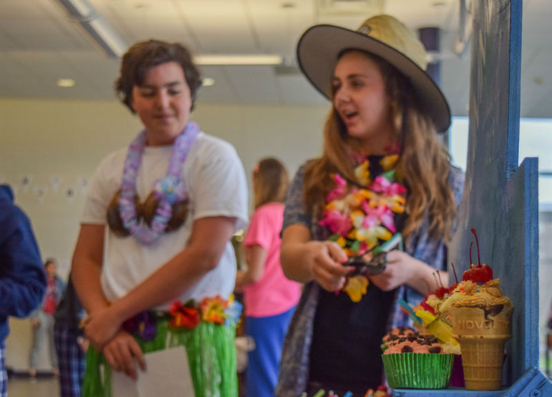 Sophomores+Grace+Treshock+of+Wall+and+Liam+Marshall+of+Sea+Bright+explain+their+summer+themed+cupcake+display.