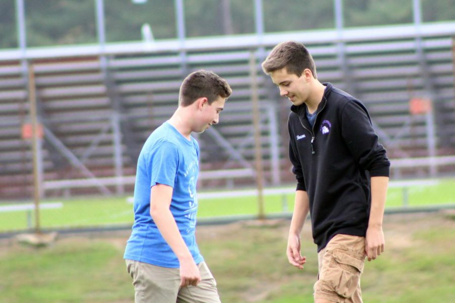 Part of their daily routine, sophomores Zach Weisenstein, left, of Freehold and Ben Hewson of Fair Haven take a moment to catch their breath while playing football outside with their friends.