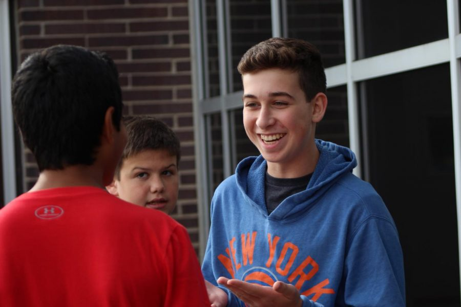 Sophomores and freshmen often go outside to play basketball during lunch. Sophomore Zach Weisenstein of Freehold, right, laughs as he and sophomore Matt Emery of Ocean talk to freshmen about 3v3.