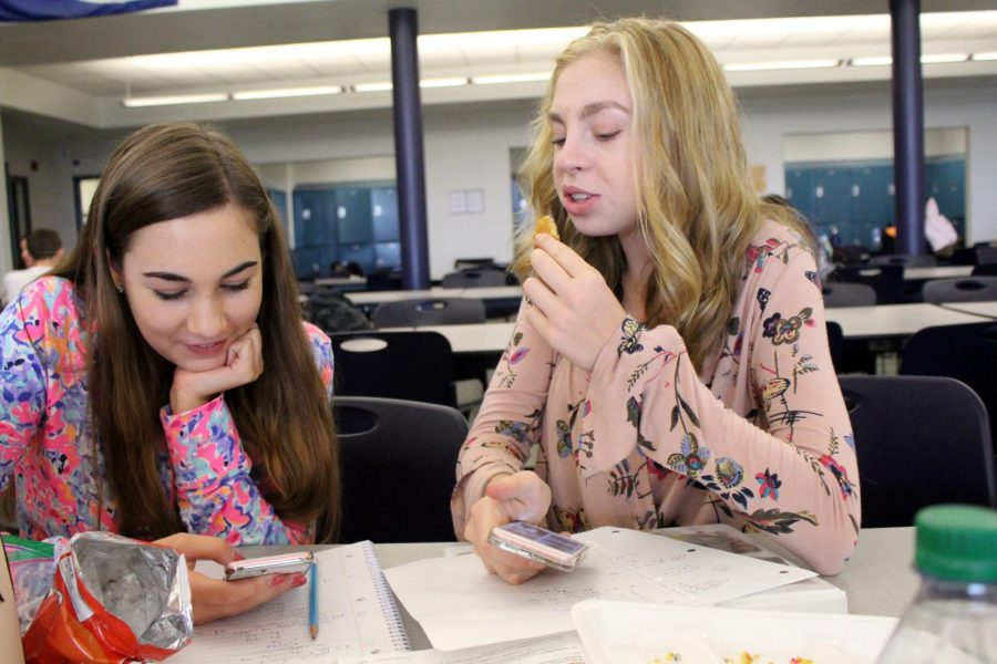 Both cramming for their Algebra 2 test that they have third period, juniors Avery Lima, left, of Neptune and Greer Shanley of Fair Haven do practice problems and enjoy sugar cookies from the cafeteria. The cookies are sold every day for 60 cents.