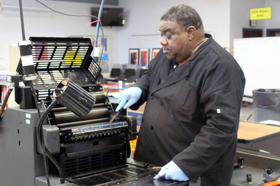 Print Production teacher Bill Allen prepared a printer at lunch. This Monday he is giving a presentation at the Fall Press Day at Rutgers University.