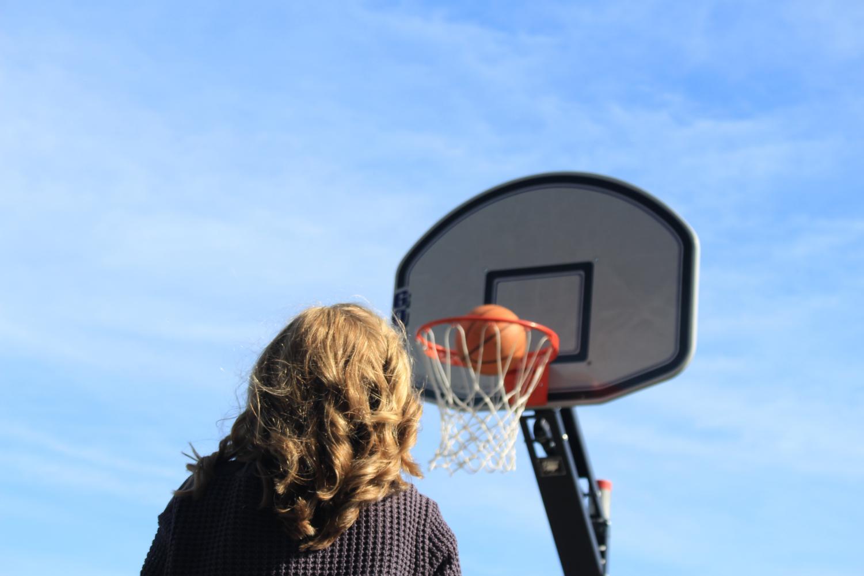 During+a+brief+basketball+pickup+game%2C+junior+Greer+Shanley+of+Fair+Haven+shoots+hoops+with+math+teacher+Scott+Stengele.