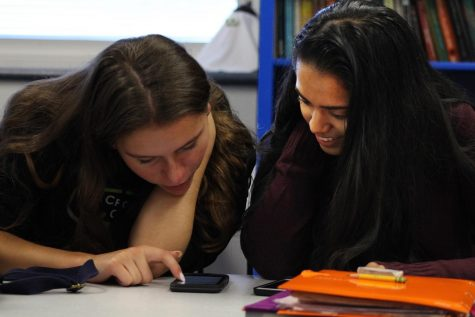 During third period, juniors Khushi Kadakia, right, of Tinton Falls and Colleen Megerle, left, of Colts Neck practice their dialogue, a regularly assigned project by Spanish teacher Gail Plumeri.
