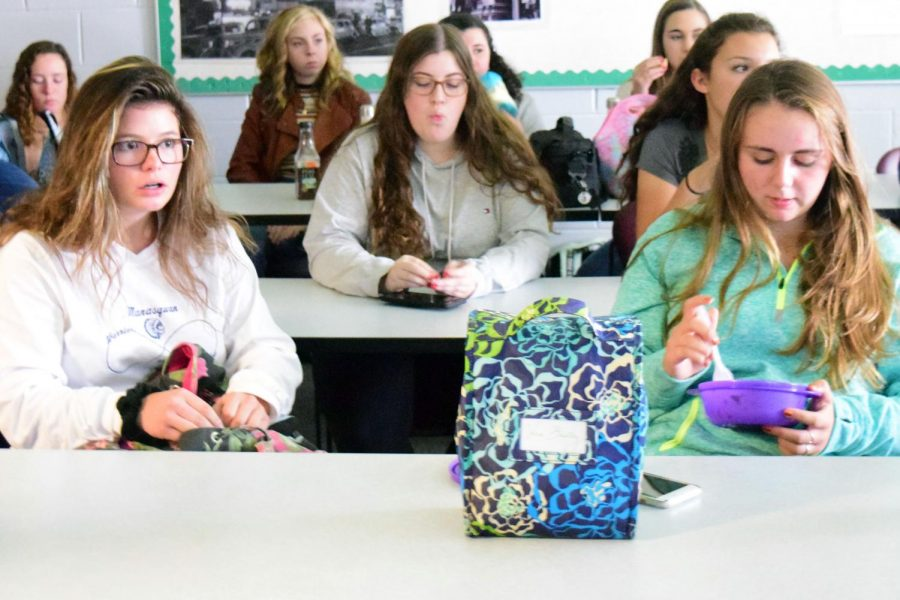 Juniors Alex Herrmann of Brielle and Grace Treshock of Monmouth Beach absorb the new information about Penny Wars and the upcoming Spirit Week at today's junior class meeting.