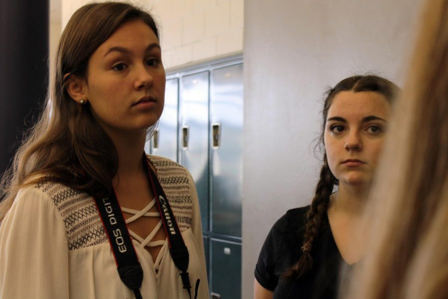 Before the Class of 2019 meeting, juniors Allie Beekman, left, of Neptune and Amanda DiBenedetto, right, of Ocean listen to junior class council member Rebecca Rippon of Ocean as she tells them which events will be discussed at the upcoming meeting held second half of lunch.