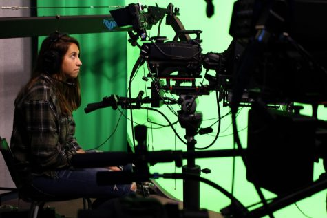 "While rehearsing for CHS's live morning show ""Views From the Studio,"" junior Kate Dickenson of Spring Lake Heights listens to her classmates' directions as the bell nears and they prepare to go live for a five minute broadcast to the school."
