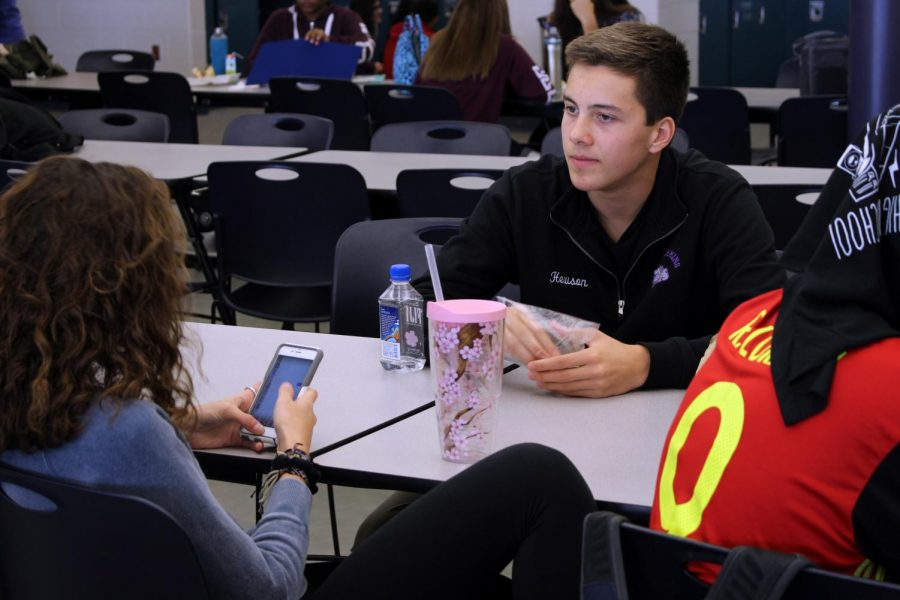 As lunch reaches its halfway point, sophomore Ben Hewson of Fair Haven, who has finished eating, listens to his friends talk. The sophomores could relax all lunch period, unlike the juniors and seniors who both had mandatory class meetings second half of lunch.