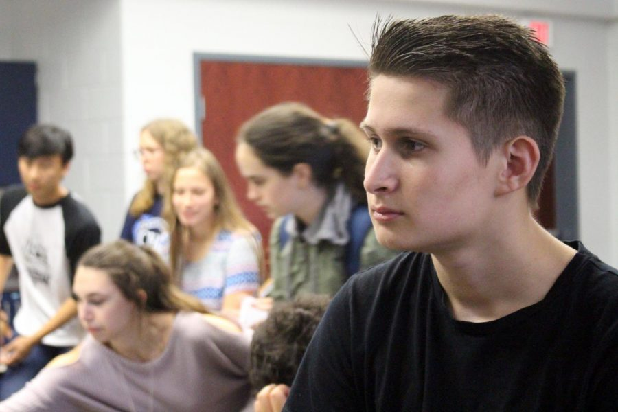 During a CCC meeting first half of lunch, junior Michael Topper of Ocean listens as the club's council announced their upcoming events, including the Special Needs Harvest Festival at Allaire Community Farms.