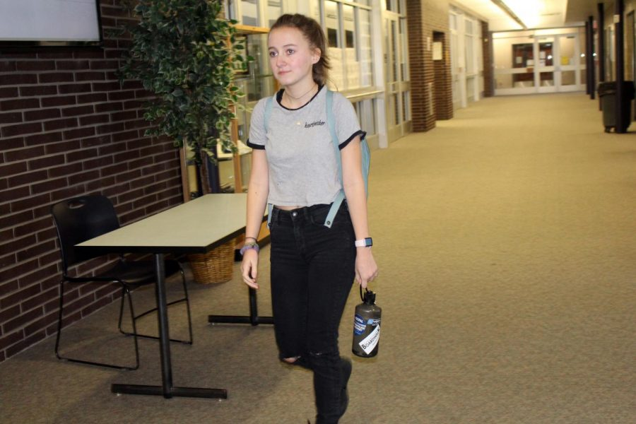 At the start of fourth period, senior Caroline Savage of Brielle walks through the front hallway to class. Savage decorates her Nalgene water bottle with stickers of things important to her.