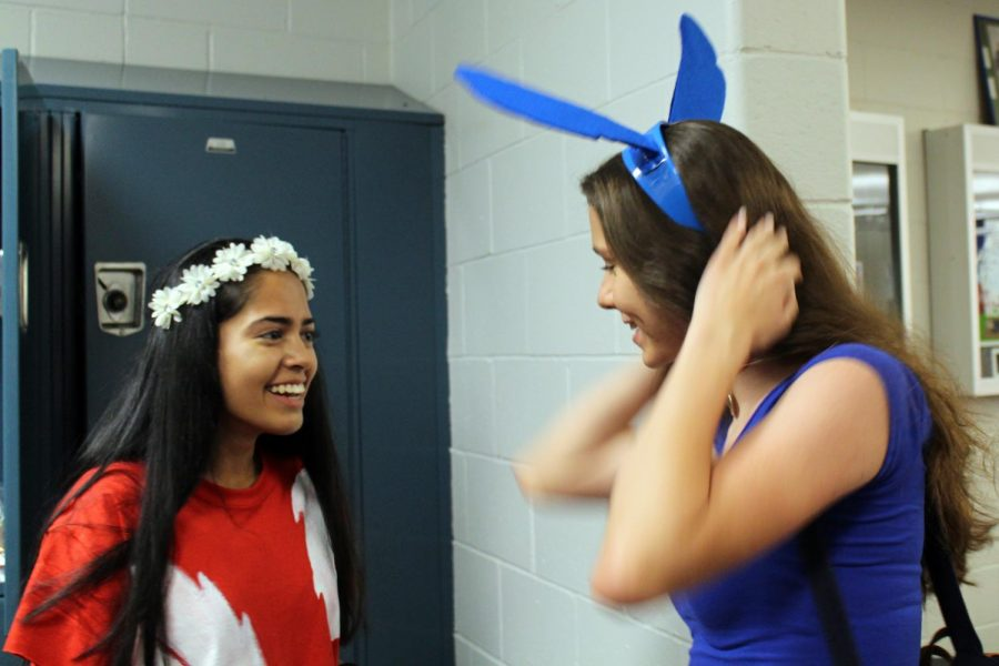 While walking into her locker pod, junior Colleen Megerle of Colts Neck puts on her Stitch ears. Junior Khushi Kadakia of Tinton Falls is Megerle's Lilo for the day.