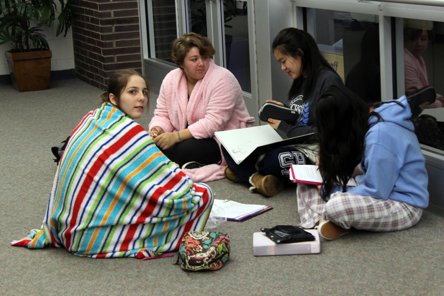 The+Spirit+Week+theme+on+Friday+was+Pajama+Day.+From+left%2C+juniors+Cecilia+Heidelberger+of+Middletown%2C+Merina+Spaltro+of+Allentown%2C+Caitlin+McLaughlin+of+Middletown+and+Angelina+Cheng+of+Marlboro+continue+their+daily+activities+during+lunch+except+dressed+in+robes%2C+slippers+and+blankets.