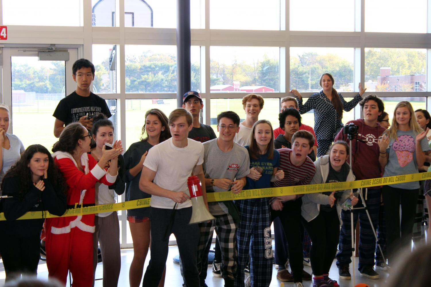 Members+of+the+senior+class+collectively+watch+the+Dodgeball+game+and+cheer+for+their+class+during+the+semifinals+game+between+the+sophomores+and+the+seniors.