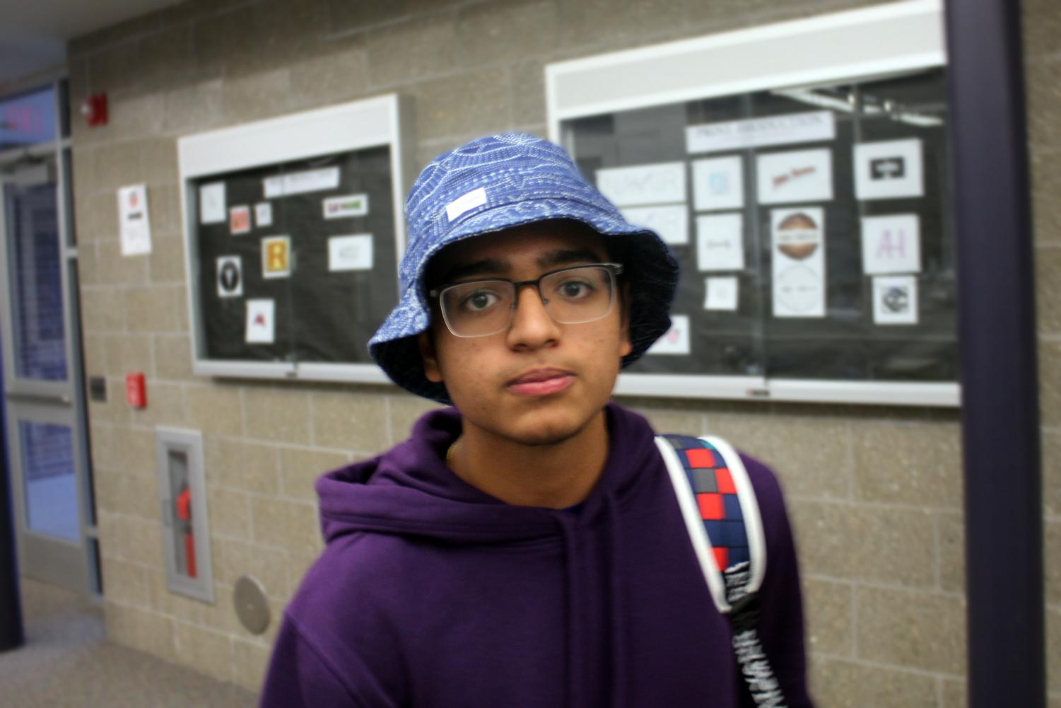 Students+dressed+in+Hawaiian+shirts+and+sunglasses+on+Thursday+to+earn+participation+points+for+Tourist+Day.+Junior+Parthesh+Patel+of+Freehold+wears+a+bucket+hat.+%E2%80%9CI+feel+that+it+brings+out+my+more+tropical+side%2C%E2%80%9D+Patel+said.