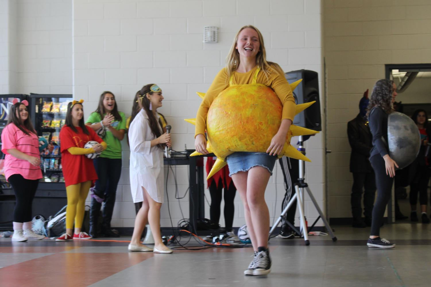 Dressed+as+the+2017+solar+eclipse%2C+juniors+Caroline+Monaghan+of+Middletown+and+Emma+Hecht+of+Wall+took+home+Best+Couple+at+the+Halloween+parade.+Monaghan+and+Hecht+recorded+an+audio+track+that+played+as+they+walked+across+the+cafeteria.