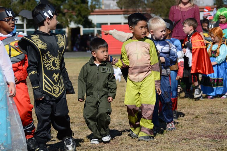 Halloween is characterized by costumes and parades, which some elementary and middle schools are considering banning.