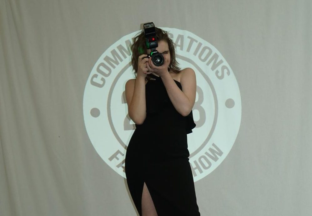 Rasp shows off her love for photography on the CHS runway.