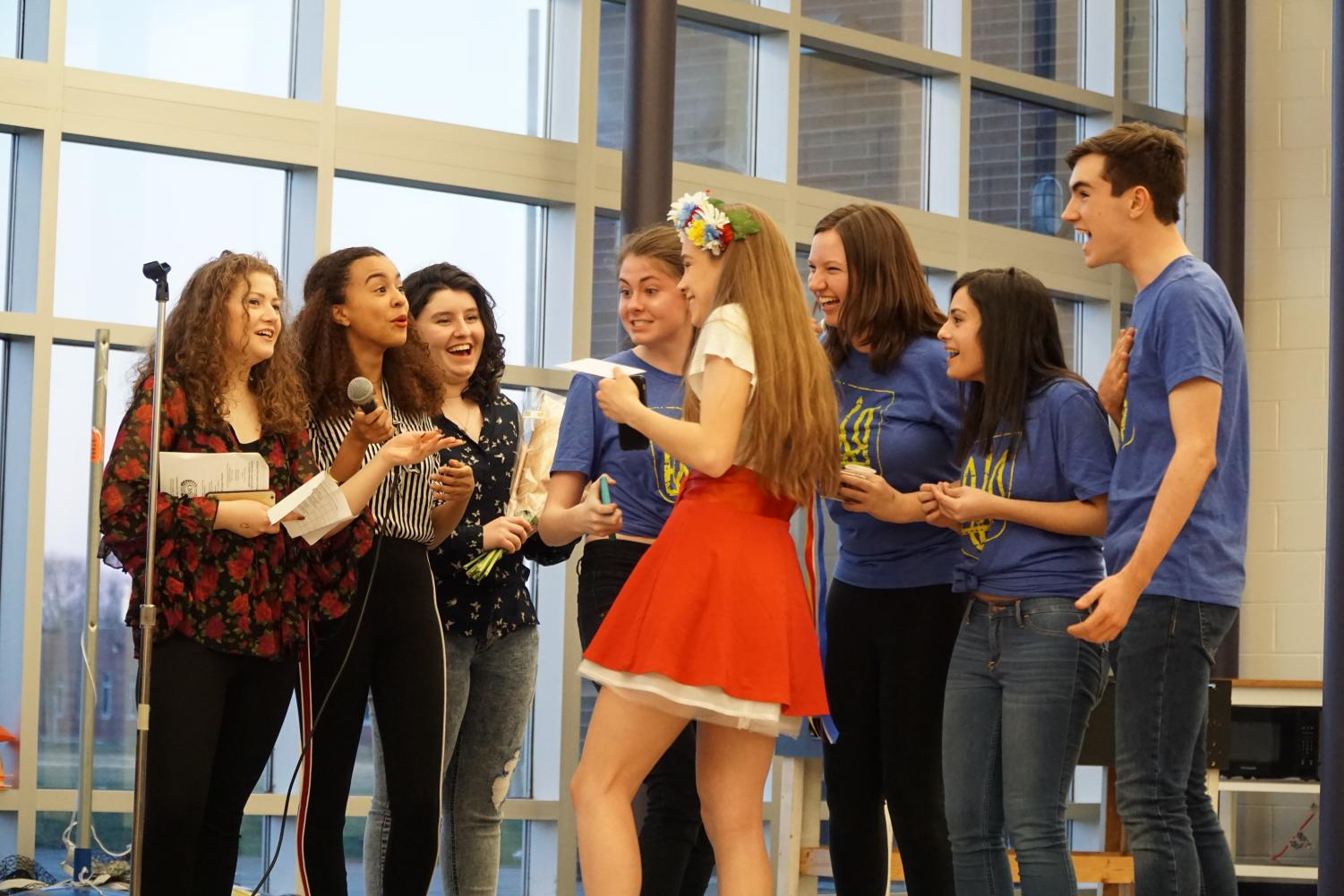 CCC council members, from left, senior Veronica Yaron of Little Silver, junior Sydney Karlin of Matawan and senior Mary Lykes of Howell announce Ukraine as the winner of the annual CCC Festival. The country comprised of five juniors, Jillian Lynch of Interlaken, Erica Sammarco of Colts Neck, Grace McCaffrey of Middletown, Alexis Colucci of Middletown and Connor Martin of Spring Lake Heights.