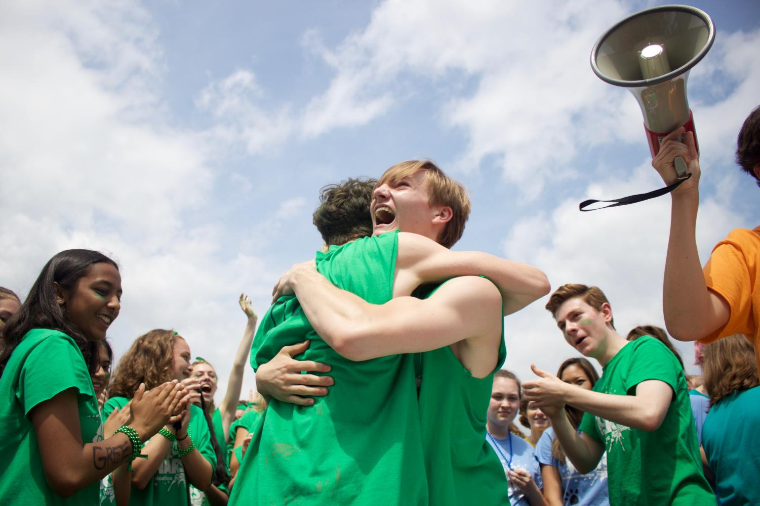 Green+Team+captain+and+senior+Jonathan+Slovak+of+Spring+Lake+Heights+hugs+his+fellow+Green+Team+captain+and+senior+Matt+Avena+of+Middletown+after+Avena+wins+the+pie-eating+competition+against+the+Red+Team.+