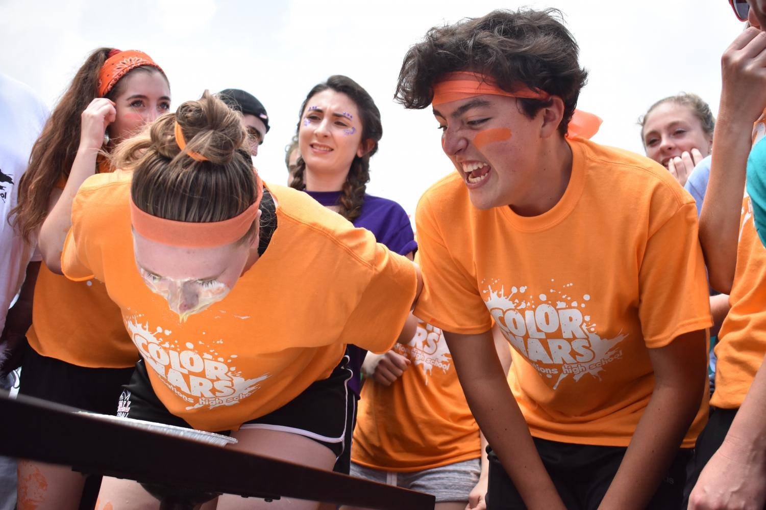Junior+Liam+Marshall+of+Sea+Girt+cheers+on+Orange+Team+captain+and+senior+Megan+Stanislowski+of+Wall+as+she+represents+her+team+during+the+pie-eating+competition.+