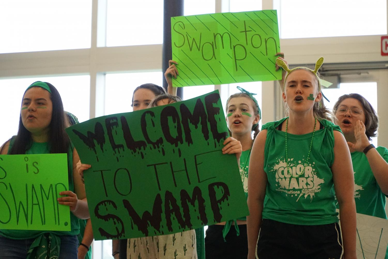 Sophomores+and+juniors+from+the+Green+Team+chant+with+signs.+The+Green+Team%2C+also+called+The+Swamp%2C+placed+third+in+team+chants.