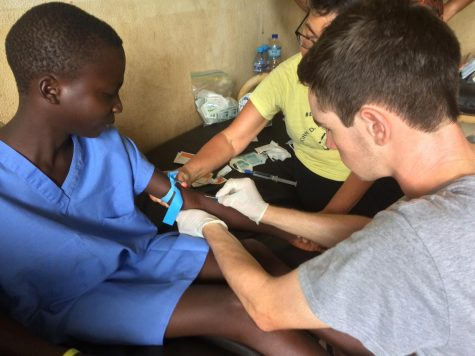 Senior Connor Martin of Spring Lake Heights learned various ways to treat injured patients during his service trip to Africa.