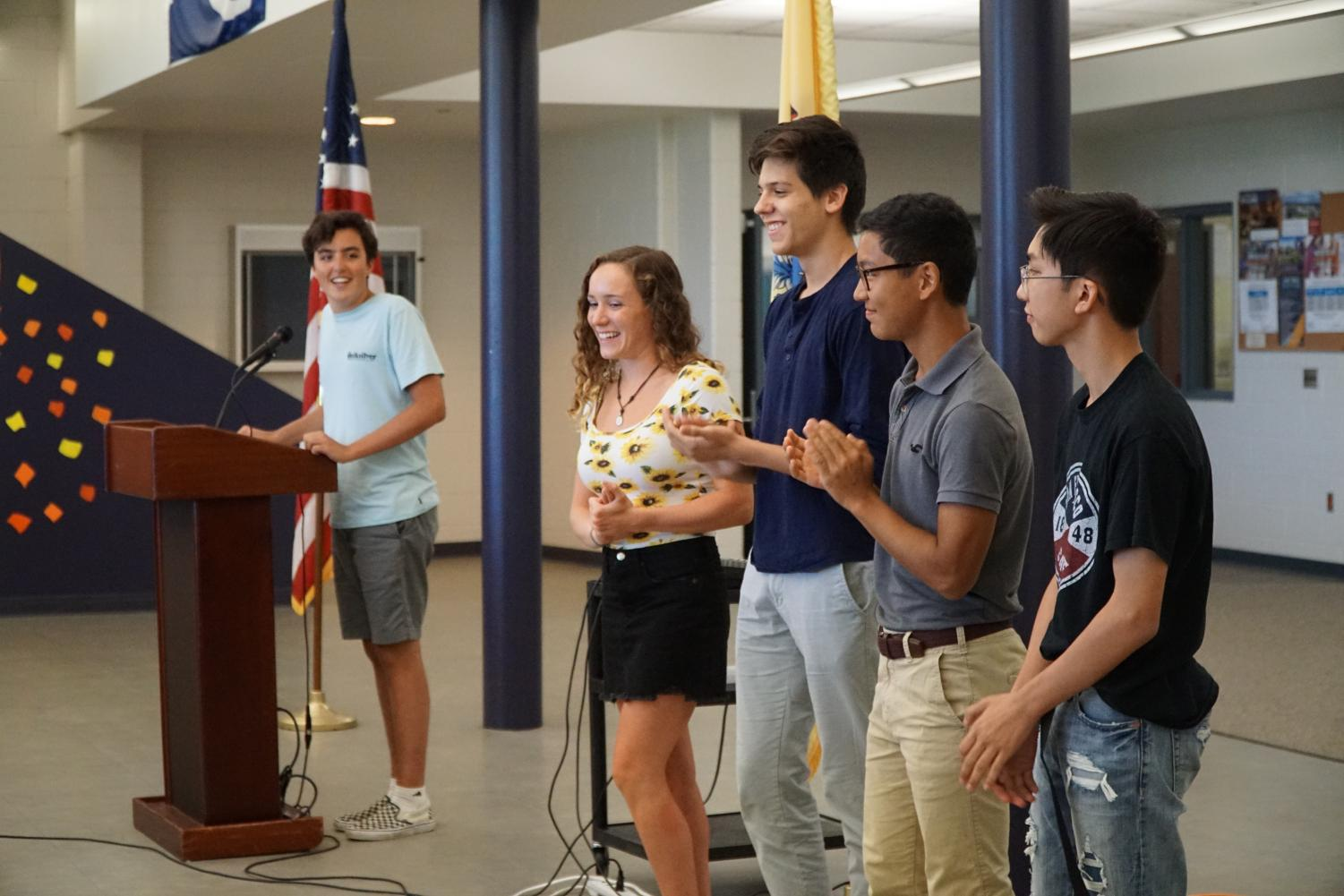 Senior and SGA President Liam Marshall, left, announces the rest of the 2018-19 SGA: senior and Vice President Emma Hecht of Wall and junior council members Dane Tedder of Ocean, Evan Kuo of Tinton Falls and Liam Jamolod of Howell.