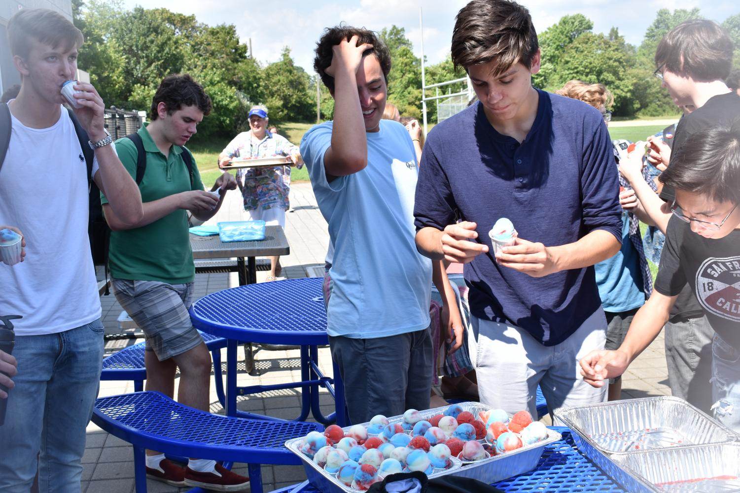 Senior and SGA president Liam Marshall of Sea Girt, center, and junior and SGA member Dane Tedder of Ocean, right, hand out Italian ices on the first day of school.