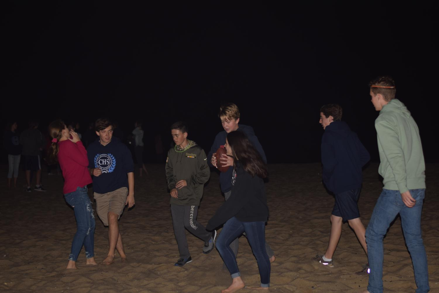 Freshmen play football on the beach during the PSFA event on Oct. 5.