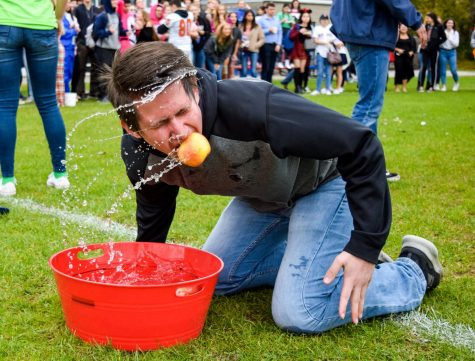 Fall Spirit Week 2018 began on Monday, Oct. 29 with Character Day and the fall-themed relay competition. The event took place on the back patio due to some events being impractical for taking place indoors. Senior Michael Topper of Ocean competes in the apple bobbing portion of the competition.